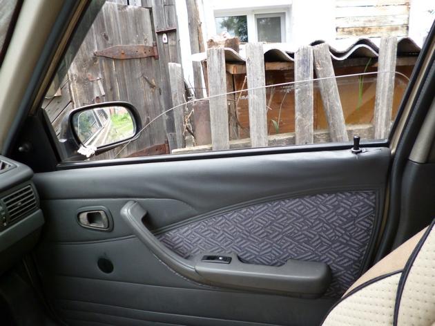 """Установка электростеклоподъемников """"КАТРАН"""" в передние двери Daewoo Nexia. Рис 13"""